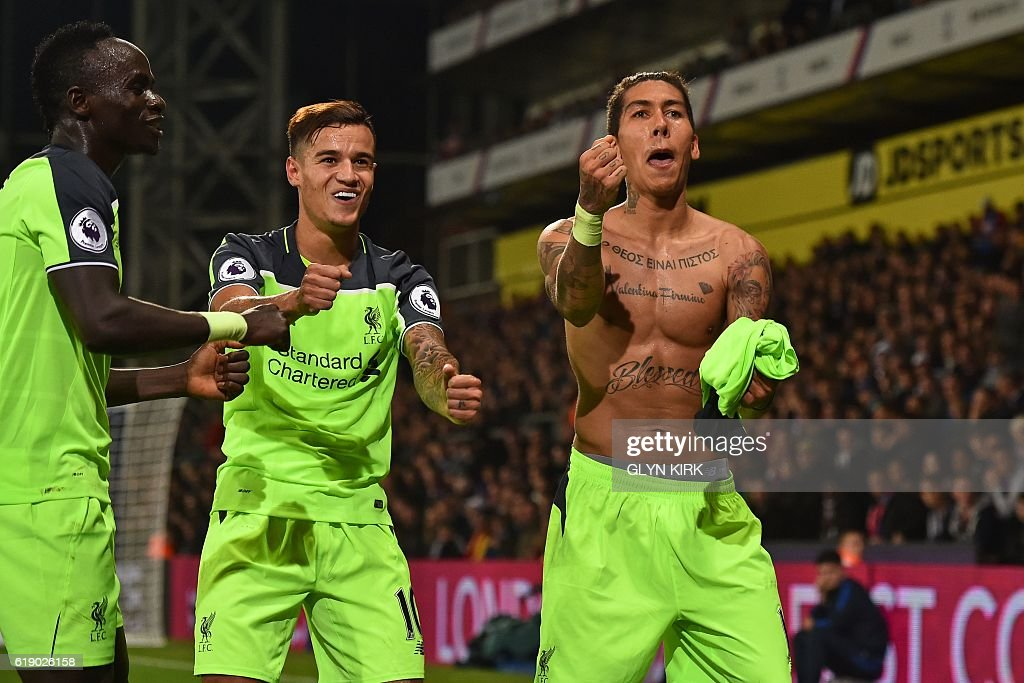 Liverpool's Brazilian midfielder Roberto Firmino (R) celebrates with Liverpool's Senegalese midfielder Sadio Mane (L) and Liverpool's Brazilian midfielder Philippe Coutinho after scoring their fourth goal during the English Premier League football match between Crystal Palace and Liverpool at Selhurst Park in south London on October 29, 2016. / AFP / Glyn KIRK / RESTRICTED TO EDITORIAL USE. No use with unauthorized audio, video, data, fixture lists, club/league logos or 'live' services. Online in-match use limited to 75 images, no video emulation. No use in betting, games or single club/league/player publications. /