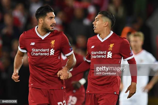 Liverpool's Brazilian midfielder Roberto Firmino celebrates with Liverpool's German midfielder Emre Can after scoring during the UEFA Champions...