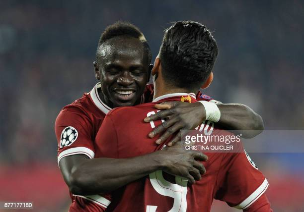 Liverpool's Brazilian midfielder Roberto Firmino celebrates with Liverpool's Senegalese midfielder Sadio Mane after scoring a goal on November 21...
