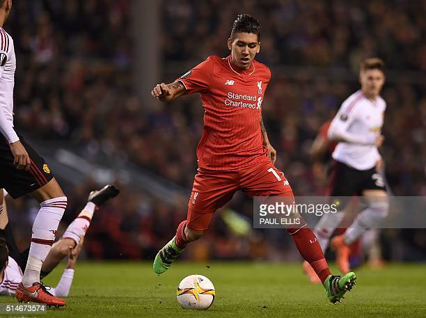 Liverpool's Brazilian midfielder Roberto Firmino controls the ball during the UEFA Europa League round of 16 first leg football match between...