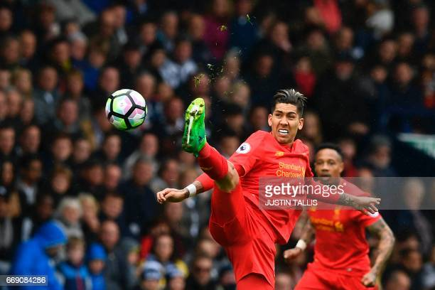 Liverpool's Brazilian midfielder Roberto Firmino controls the ball during the English Premier League football match between West Bromwich Albion and...