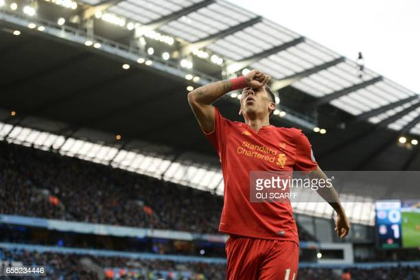 Liverpool's Brazilian midfielder Roberto Firmino reacts after missing a chance during the English Premier League football match between Manchester...
