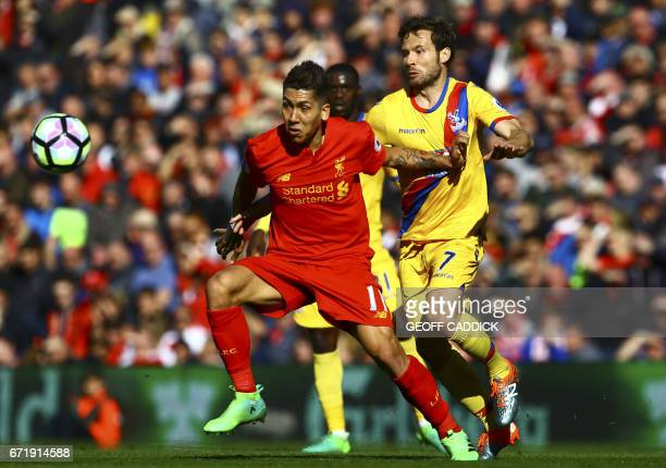 Liverpool's Brazilian midfielder Roberto Firmino vies with Crystal Palace's French midfielder Yohan Cabaye during the English Premier League football...