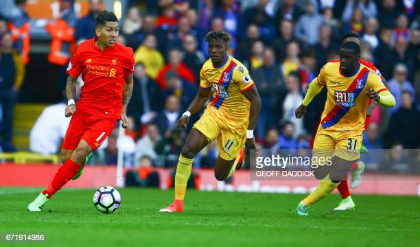 Liverpool's Brazilian midfielder Roberto Firmino vies with Crystal Palace's Ivorian striker Wilfried Zaha and Crystal Palace's German defender...