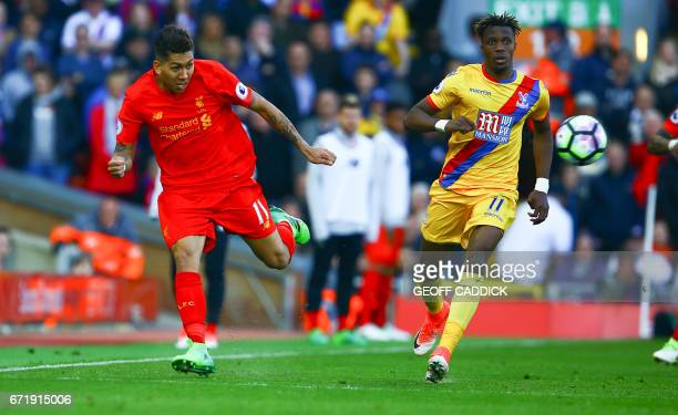 Liverpool's Brazilian midfielder Roberto Firmino vies with Crystal Palace's Ivorian striker Wilfried Zaha during the English Premier League football...