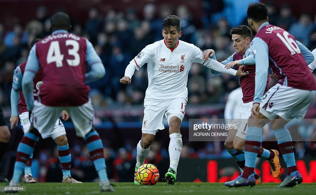 Liverpool's Brazilian midfielder Roberto Firmino vies with the Villa defence during the English Premier League football match between Aston Villa and Liverpool at Villa Park in Birmingham, central England on February 14, 2016. / AFP / ADRIAN DENNIS / RESTRICTED TO EDITORIAL USE. No use with unauthorized audio, video, data, fixture lists, club/league logos or 'live' services. Online in-match use limited to 75 images, no video emulation. No use in betting, games or single club/league/player publications. /