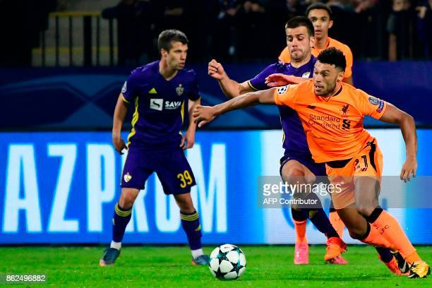 Liverpool's British midfielder Alex OxladeChamberlain vies with Maribor's Slovenian defender Mitja Viler during the UEFA Champions League group E...