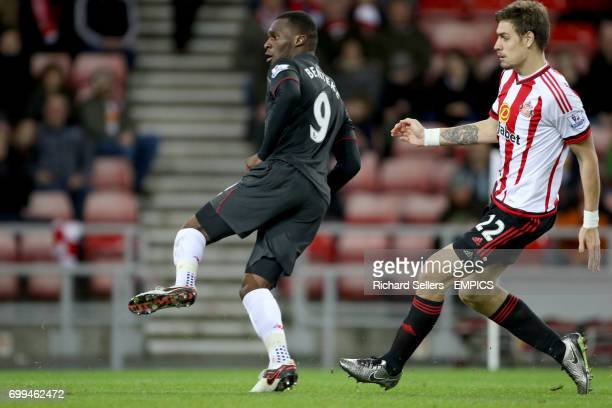 Liverpool's Christian Benteke scores his side's first goal of the game