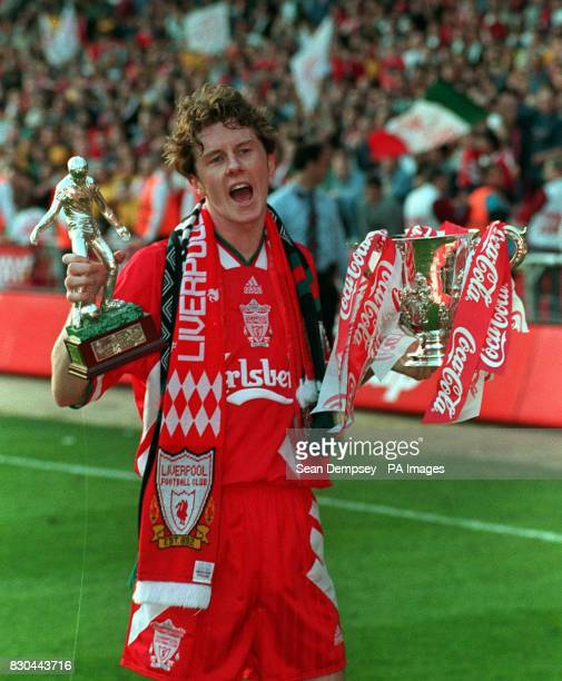 Liverpool's CocaCola Cup hero Steve McManaman with the trophy after his decisive twogoal strike sunk First Division Bolton Wanderers during their Cup...