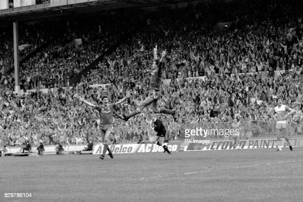 Liverpool's Craig Johnston leaps high to celebrate giving his team a 21 lead as teammate Ian Rush runs to congratulate him