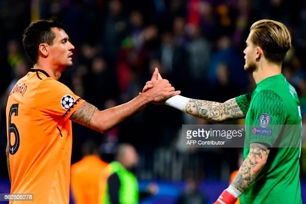Liverpool's Croatian defender Dejan Lovren and Liverpool's German goalkeeper Loris Karius celebrate at the end of the UEFA Champions League group E...