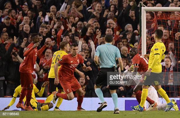 Liverpool's Croatian defender Dejan Lovren celebrates after scoring the winning goal during the UEFA Europa league quarterfinal second leg football...