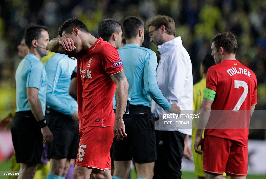 Liverpool's Croatian defender Dejan Lovren gestures at the end of the UEFA Europa League semifinals first leg football match Villarreal CF vs Liverpool FC at El Madrigal stadium in Vila-real on April 28, 2016. / AFP / JOSE