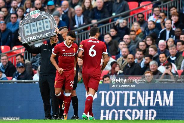 Liverpool's Croatian defender Dejan Lovren is substituted for Liverpool's English midfielder Alex OxladeChamberlain during the English Premier League...
