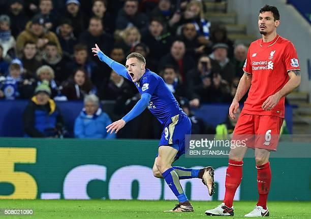 Liverpool's Croatian defender Dejan Lovren looks on as Leicester City's English striker Jamie Vardy celebrates scoring the opening goal of the...