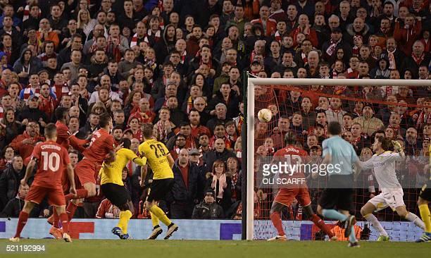 Liverpool's Croatian defender Dejan Lovren scores the winning goal during the UEFA Europa league quarterfinal second leg football match between...