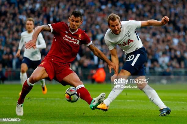 Liverpool's Croatian defender Dejan Lovren vies with Tottenham Hotspur's English striker Harry Kane during the English Premier League football match...
