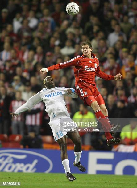 Liverpool's Daniel Agger and Arouna Kone battle for the ball during the UEFA Champions League Group C match against PSV Eindhoven at Anfield Stadium...