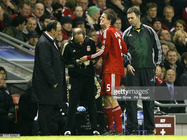 Liverpool's Daniel Agger has his finger reset by the physio