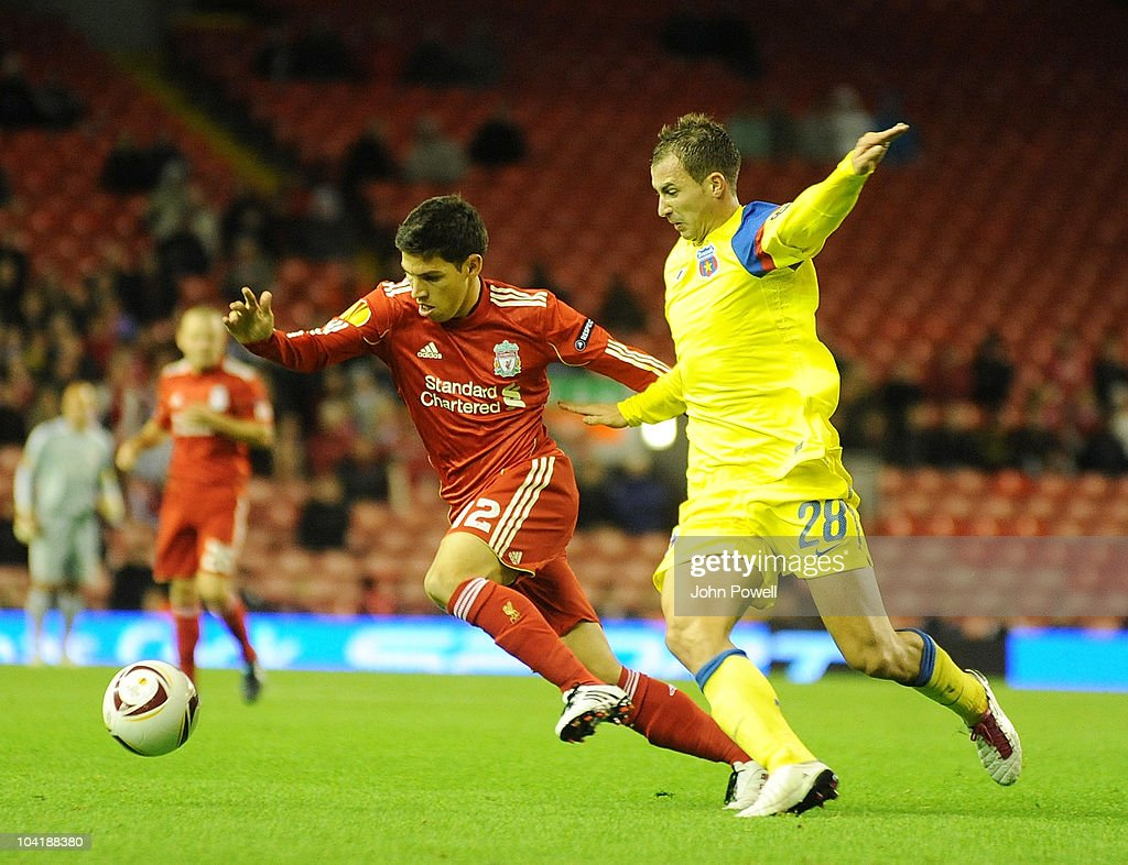 Liverpool's Daniel Pacheco tussles with Bogdan Stancu of Steau Bucharest during the first leg UEFA Europa League match between Liverpool and Steau Bucharest on September 16, 2010 in Liverpool, England.