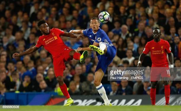 Liverpool's Daniel Sturridge and Chelsea's Nemanja Matic battle for the ball