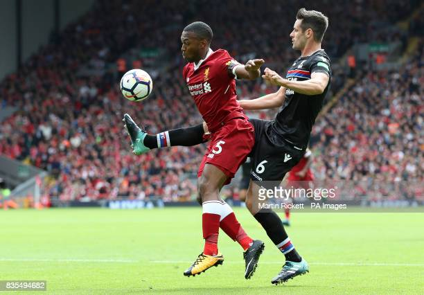 Liverpool's Daniel Sturridge and Crystal Palace's Scott Dann battle for the ball during the Premier League match at Anfield Liverpool