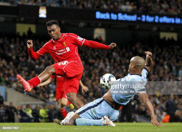 Liverpool's Daniel Sturridge and Manchester City's Vincent Kompany battle for the ball during the Barclays Premier League match at the Etihad Stadium...