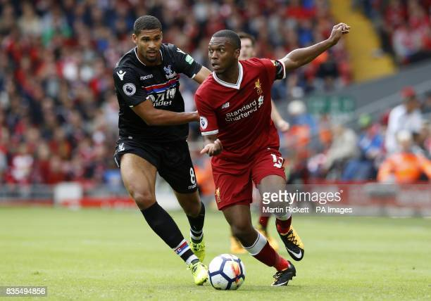 Liverpool's Daniel Sturridge battles for the ball with Crystal Palace's Ruben LoftusCheek during the Premier League match at Anfield Liverpool