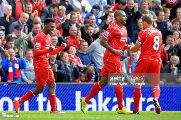 Liverpool's Daniel Sturridge celebrates scoring his side's second goal of the game with teammate Steven Gerrard during the Barclays Premier League...