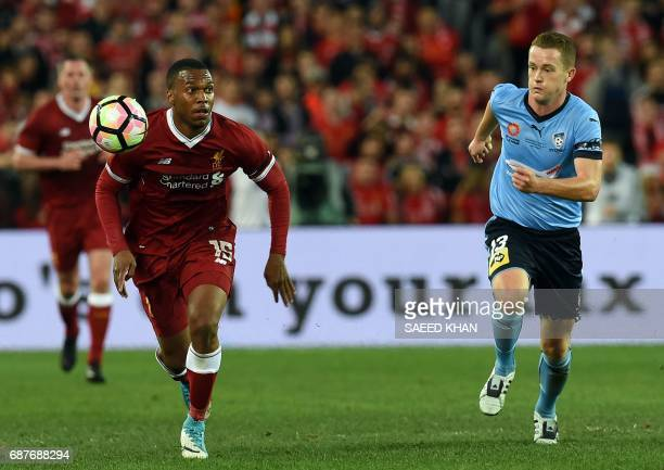 Liverpool's Daniel Sturridge controls the ball next to Sydney FC player Brandon O'Neill during their endofseason friendly football match at the...
