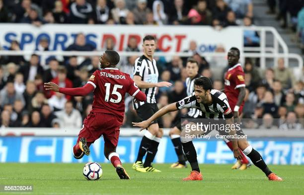 TYNE ENGLAND OCTOBER Liverpool's Daniel Sturridge goes down under the challenge from Newcastle United's Mikel Merino during the Premier League match...