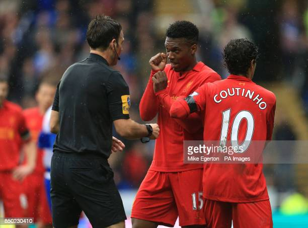 Liverpool's Daniel Sturridge has words with referee Mark Clattenburg during the Barclays Premier League match at the Madejski Stadium Reading