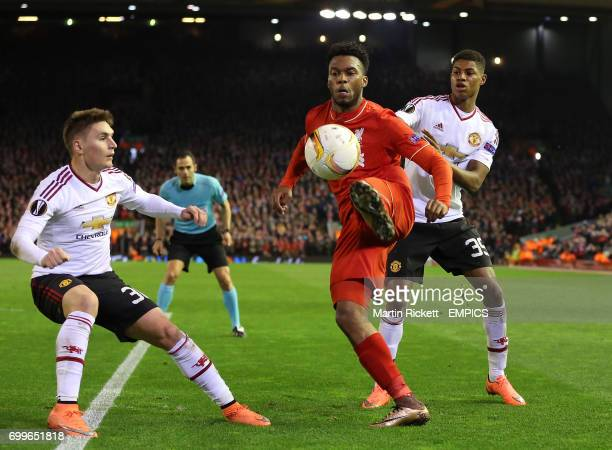 Liverpool's Daniel Sturridge in action with Manchester United's Marcus Rashford and Guillermo Varela