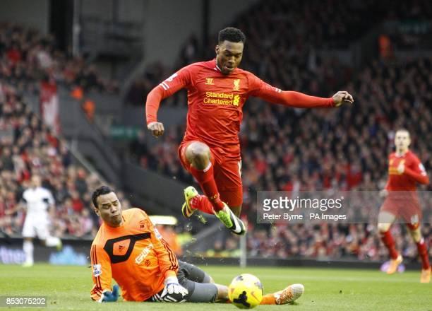 Liverpool's Daniel Sturridge leaps over Swansea goalkeeper Michel Vorm and scores his teams opening goal