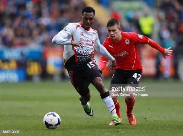 Liverpool's Daniel Sturridge takes on Cardiff City's Declan John