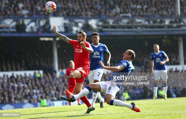 Liverpool's Danny Ings and Everton's Phil Jagielka battle for the ball
