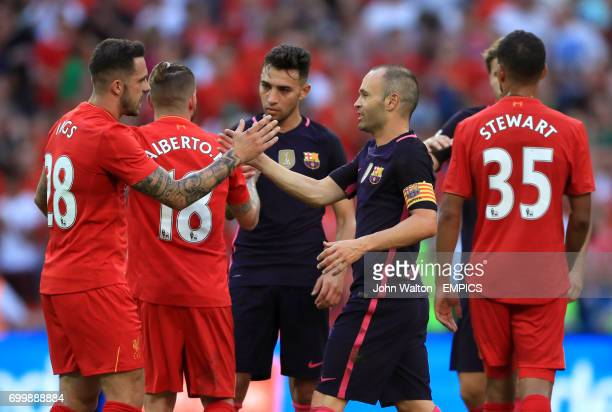 Liverpool's Danny Ings shakes hands with Barcelona's Javier Mascherano after the final whistle