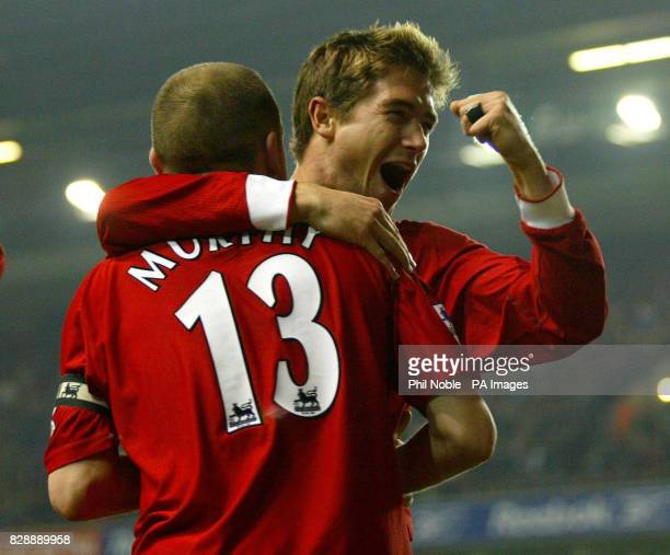 Liverpool's Danny Murphy celebrates with Harry Kewell after scoring against Bolton during the fourth round of the FA Carling Cup match at Anfield...