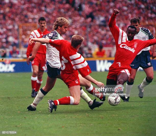 Liverpool's David Burrows and Michael Thomas attempt a tackle for the ball during their FA Cup Final against Sunderland at Wembley Stadium Final...