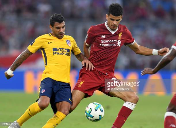 Liverpool's defender Dominic Solanke and Atletico Madrid's Argentinian midfielder Augusto vie for the ball during the final Audi Cup football match...