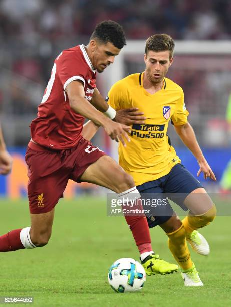 Liverpool's defender Dominic Solanke and Atletico Madrid's Croatian defender Sime Vrsalijko vie for the ball during the final Audi Cup football match...
