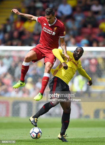 Liverpool's Dejan Lovren and Watford's Stefano Okaka battle for the ball during the Premier League match at Vicarage Road Watford