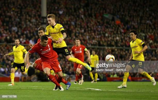 Liverpool's Dejan Lovren clears the ball away from Borussia Dortmund's Marco Reus
