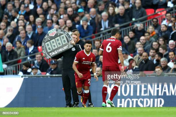 Liverpool's Dejan Lovren is substituted off the pitch for Alex OxladeChamberlain during the Premier League match at the Wembley Stadium London