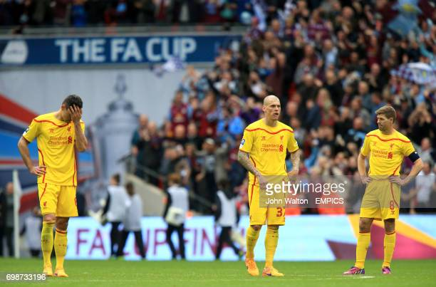 Liverpool's Dejan Lovren Martin Skrtel and Steven Gerrard stand dejected after the match