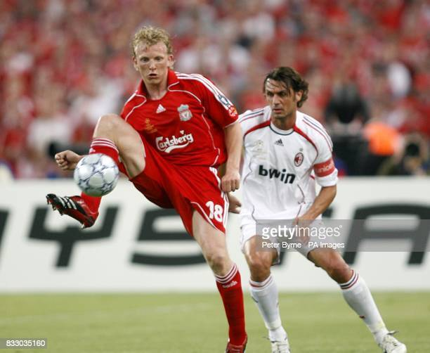 Liverpool's Dirk Kuyt and AC Milan's Paolo Maldini battle for the ball