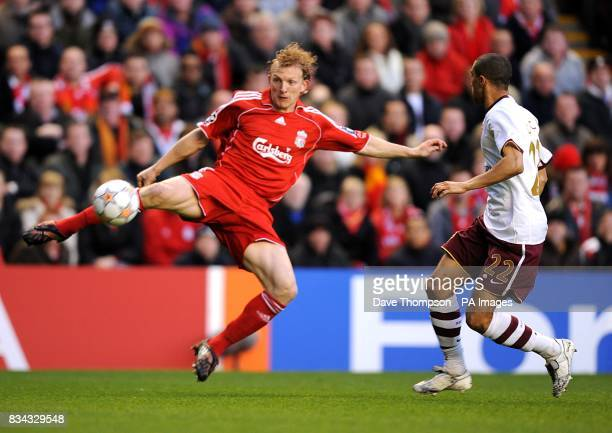 Liverpool's Dirk Kuyt and Arsenal's Gael Clichy battle for the ball