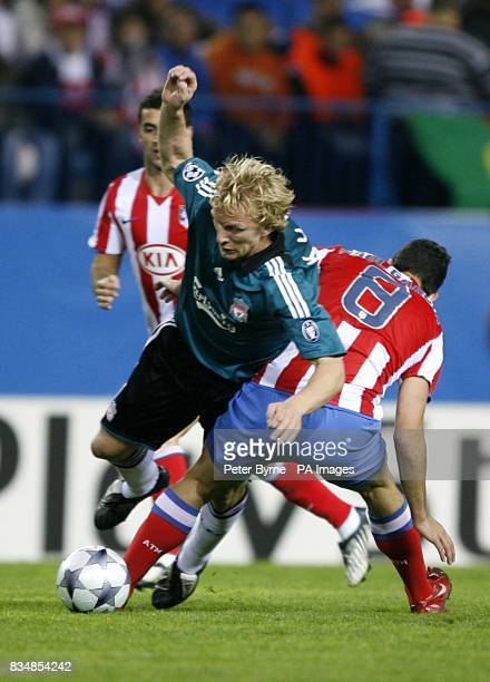 Liverpool's Dirk Kuyt and Athletico Madrid's Raul Garcia battle for the ball