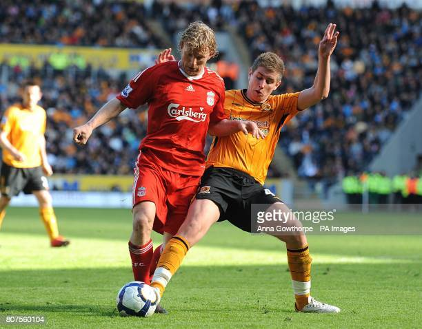 Liverpool's Dirk Kuyt and Hull City's Tom Cairney in action
