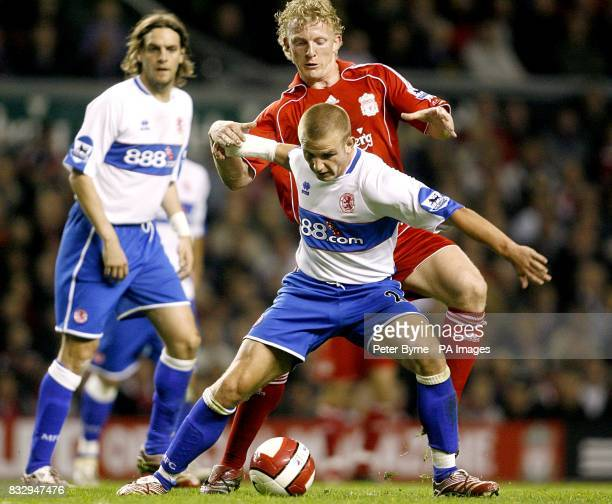 Liverpool's Dirk Kuyt and Middlesbrough's Lee Cattermole battle for the ball